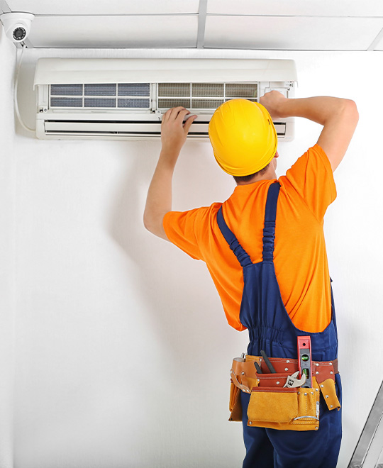 man fixing ac